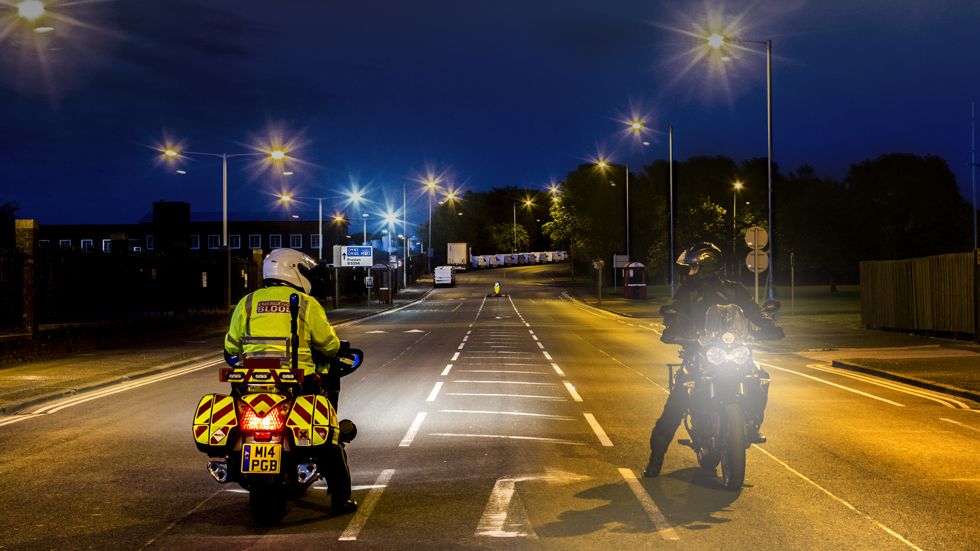 A group of Blood Bikers and their bikes